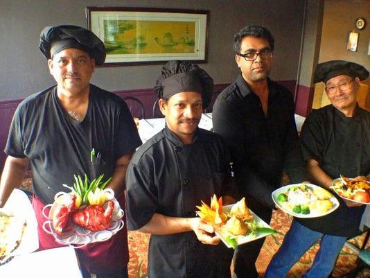2 chefs and owner Taste of Asia.jpg_20131213.jpg