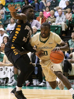 UAB forward Chris Cokley (3) drives to the inside against Southern Miss Golden Eagles forward Chip Armelin (21)  at Bartow Arena. Mandatory Credit: Marvin Gentry-USA TODAY Sports