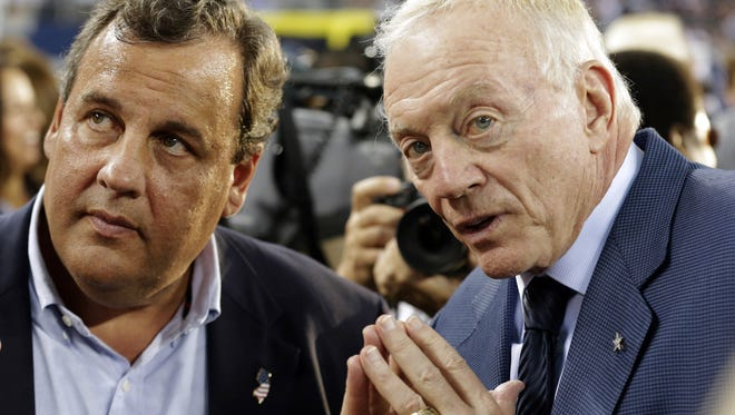 Gov. Chris Christie and Dallas Cowboys owner Jerry Jones talk before a game between the Giants and the Cowboys in September 2013 in Arlington, Texas.