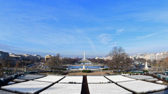 Rows of chairs stretch across the lawn on the West side of the U.S. Capitol with a view of the National Mall and the Washinghton Monument early on Jan. 15, 2017 in Washington, DC five days ahead of the inauguration of U.S. President-elect Donald Trump.