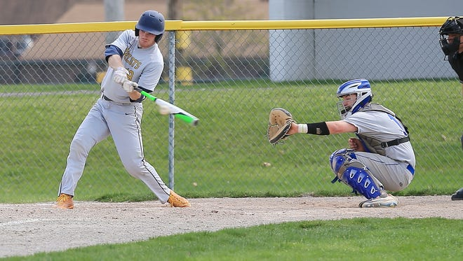Blake Sloan (19) of Schoolcraft College takes a cut during an April game at Ford Field in Livonia.