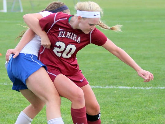 Elmira senior forward Sierra Barr goes toward the ball with a Horseheads defender draped around her during a game earlier this season.