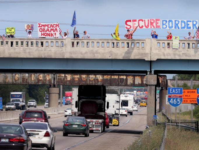 A group called Overpasses For America stand with their signs on the Madison Ave overpass over I-465 on the south side as they took part in the Secure Our Boarders National No Amnesty Rally which was held across America. Matt Kryger / The Star