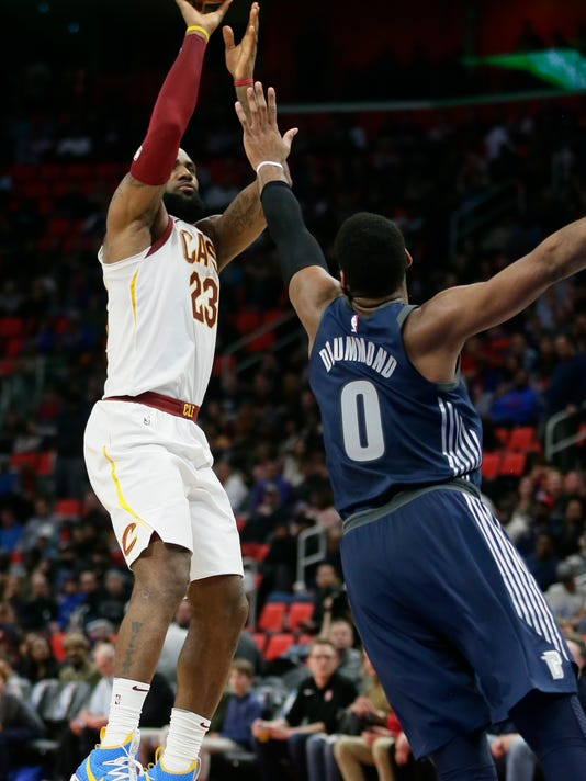 Cleveland Cavaliers forward LeBron James (23) takes a shot against Detroit Pistons center Andre Drummond (0) during the second half of an NBA basketball game Tuesday, Jan. 30, 2018, in Detroit. The Pistons defeated the Cavaliers 125-114. (AP Photo/Duane Burleson)
