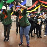 Miami Hurricanes drum major Colton Freitas urges on the crowd as the band and cheerleaders perform in the Battle of the Bands competition Friday night during the Hyundai Sun Bowl Fan Fiesta at the Judson F. Williams Convention Center.