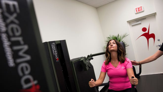 Sabrina Shell tries out the customized machines during an introductory session at ExerMedic in Naples, Fla., on Wednesday, Nov. 2, 2016. ExerMedic is a physical health program that offers private one-on-one sessions customized to the patients' conditions, including diabetes, back pain and hypertension.