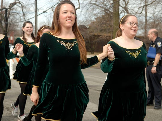 The Louisville Irish Dancers perform while walking in the St. Patrick's Day parade.  March 14, 2015