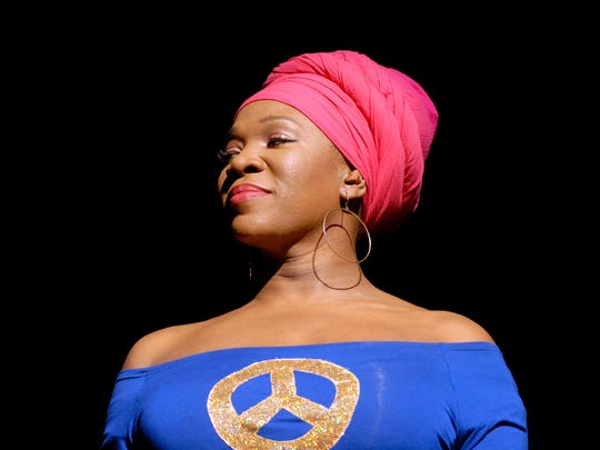 India.Arie  introduces Stevie Wonder, not pictured, before he performs at the YUM Center.  March 27, 2015 Maggie Huber, Special to The C-J