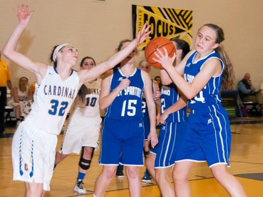 Forbes Road's McKenzie Gelvin (32) tries to block Kellyn Perry's shot for McConnellsburg. The Spartans won 45-42.