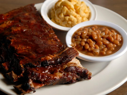 A half slab of pork ribs with a side of macaroni and cheese and baked beans at Smoketown USA.