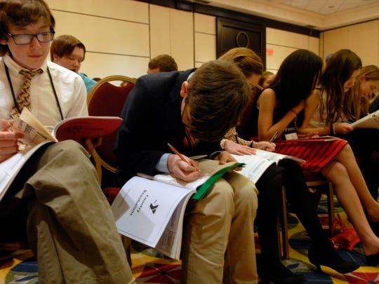 Meyzeek Middle Schooler, Wayne Kottkamp, 14, works on a speech at The Kentucky United Nations Assembly (KUNA), a 3-day experiential learning conference in which students participate directly in simulated international diplomacy, held at the Marriott Downtown.   March. 07, 2016