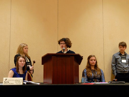 Eastside Middle Schooler, Miranda Hahn, 14, presents a resolution to a room full of students involved in The Kentucky United Nations Assembly (KUNA), a 3-day experiential learning conference in which students participate directly in simulated international diplomacy, held at the Marriott Downtown.   March. 07, 2016