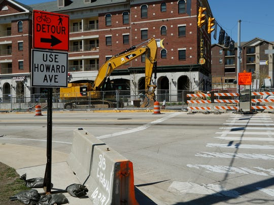 Bicycle and pedestrian traffic is detoured as work