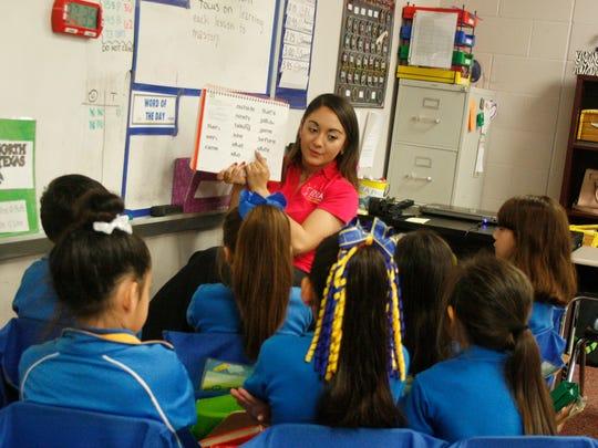 Students at IDEA Pharr Academy, a charter school in South Texas, read words aloud with their teacher.