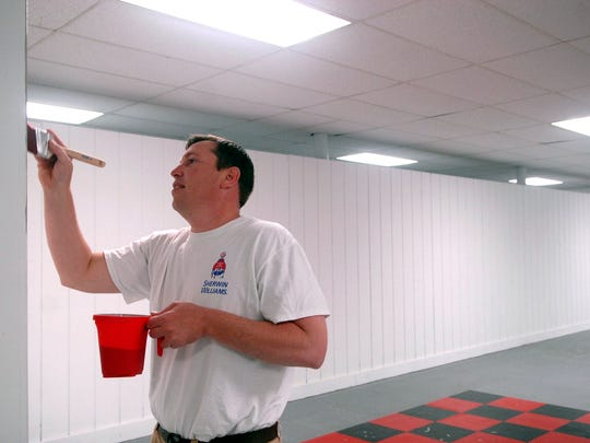 Nick Orchard paints a corner of the basement at the Mackin Community Center on 26th Street as part of the National Painting League's volunteer project.  May 20, 2016