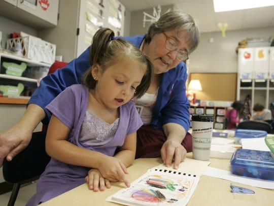 "Judy ""Grandma Judy"" Vandermark helps then-kindergartener"