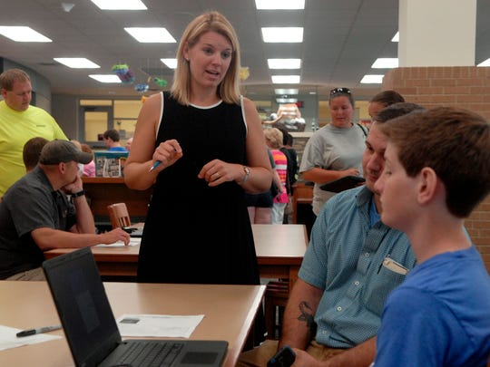 Bullitt Central High School teacher Melanie Sparks helps students log on to their laptops for the first time.  To better prepare students for an increasingly digital world, Bullitt County Public Schools will this year provide laptops to every high school freshman, sophomore and junior. Aug. 01, 2016