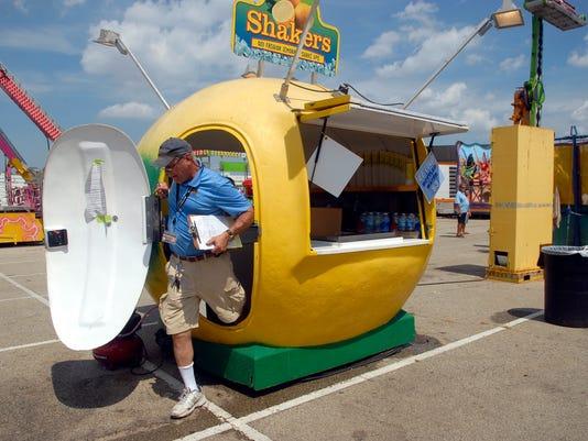 Health inspector exits a lemonade hut at Kentucky State Fair