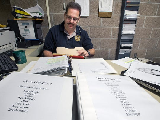 The foreground are two books of about 200 missing persons who have been eliminated in the search. West Manchester Township officer Lance Krout has taken it upon himself to identify the human skeletal remains found on Loucks Road three years ago. He searches databases, works with the FBI and Smithsonian Institute and determines what technology can help him.