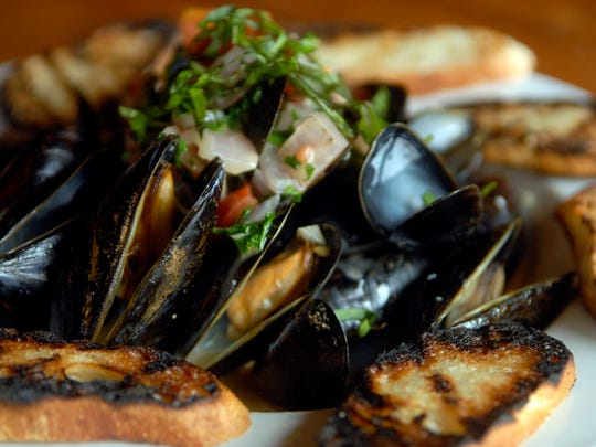 Steamed mussels with white wine cream sauce made by
