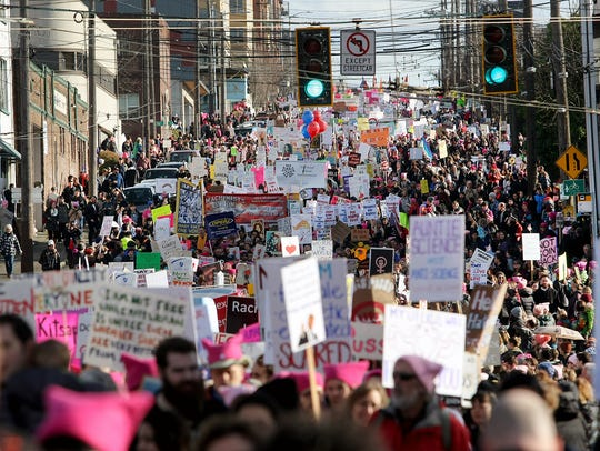 Marchers flood Jackson Street during the Seattle Womxn's