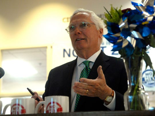 County Attorney Mike O'Connell speaks to a crowd at