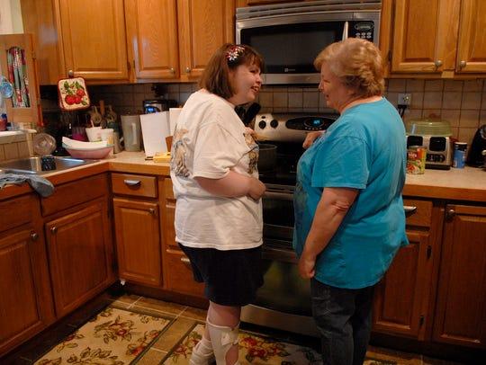 Stephanie Rudy, 32, helps her mother, Martha make a