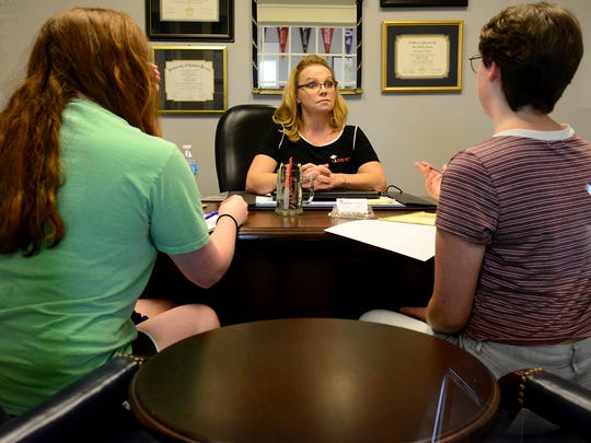 Nina Heckler with Class 1010 talks with Lauren Ragsdale and Sara Thompson at her office, Tuesday, August 8.