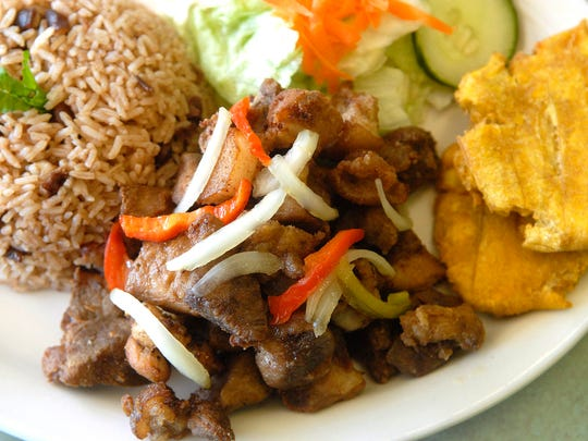 The fried pork chunks (Groit) ($8.50/ $10.50) at Caribbean Cafe, Authentic Haitian Cuisine, located at 317 W. Woodlawn Ave. in the Beechmont neighborhood. Pork chunks marinated in creole seasonings then deep fried.  April 3, 2018