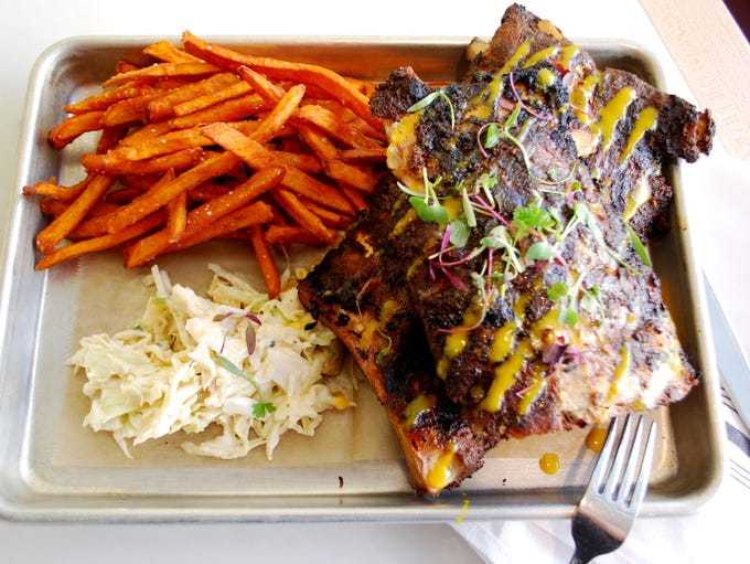 Kitchen Peppered Ribs with sweet potato fries and slaw