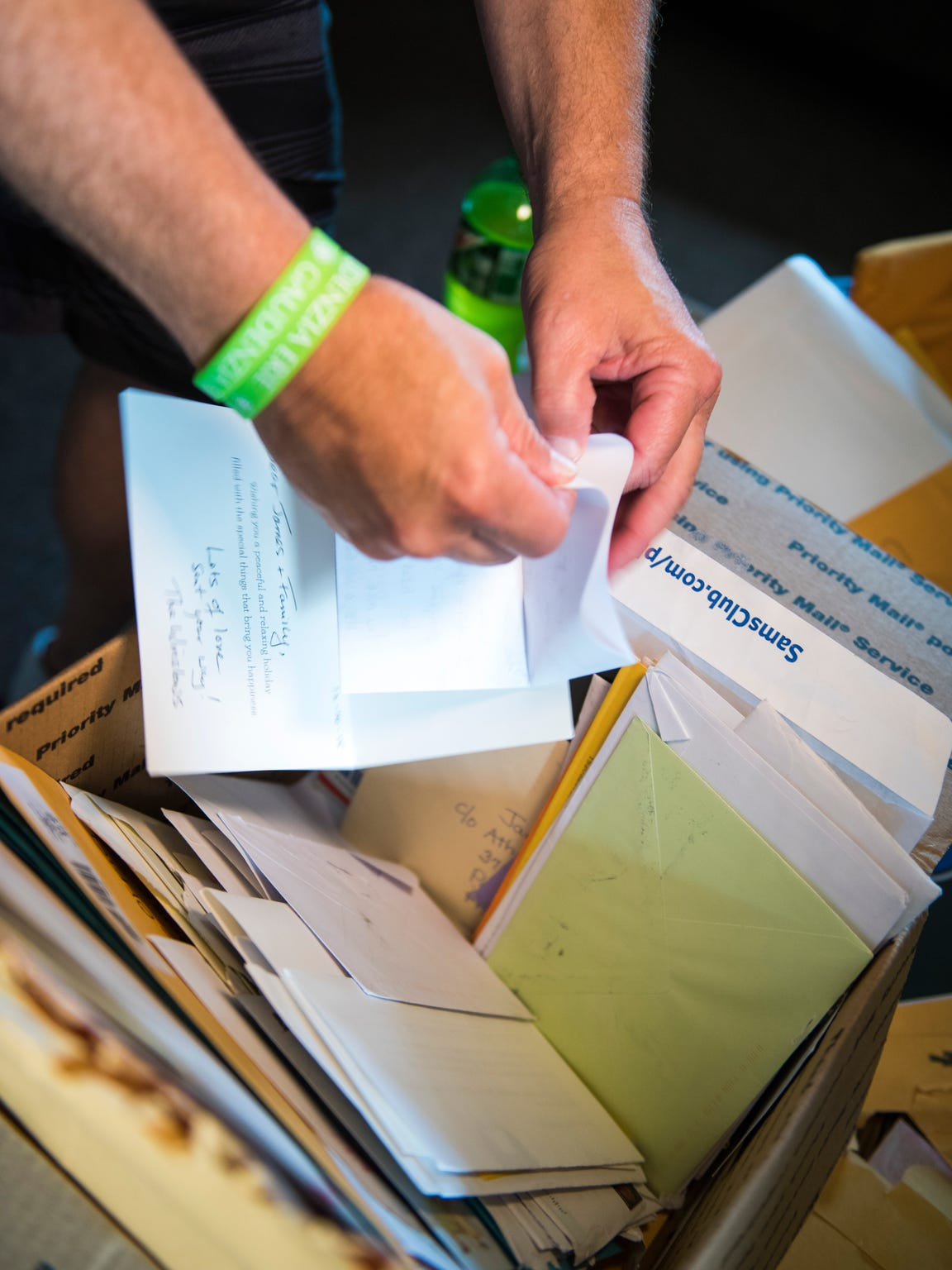 Conner family friend Mike Gallagher sorts through boxes