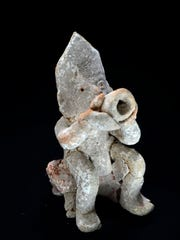 This conch blower figurine, from Belize dating from