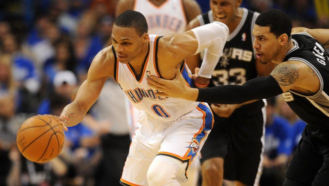 Oklahoma City's Russell Westbrook, left, steals the ball from San Antonio's Danny Green in the second quarter of Game 4 of the Western Conference finals on Tuesday.