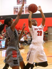 Stewarts Creek's Lauren Flowers (20) goes up for a shot as Coffee County's Aerial Williams (14) guards her on Friday, Feb. 24, 2017 the quarterfinal round of Regional play.