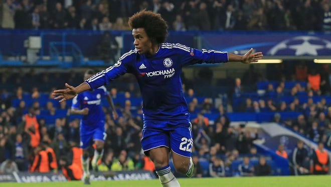 Chelsea's Willian celebrates after scoring the winning goal during the Champions League Group G soccer match against Dynamo Kiev at Stamford Bridge Stadium.