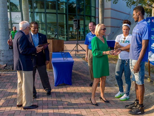 Donna and Jim Sublett greet FGCU coaches, players and administrators during the Alico Arena expansion project groundbreaking Nov. 4, 2016.