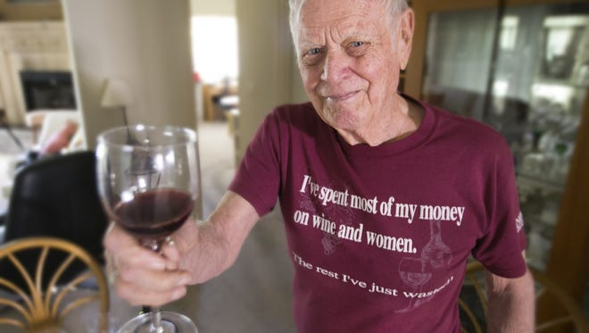 Gordon Dutt, 87, planted the first commercial vineyard in Arizona, Sonoita Vineyards in the early 1970s. He is seen holding a glass of their wine at his home in Tucson on February 8, 2017.
