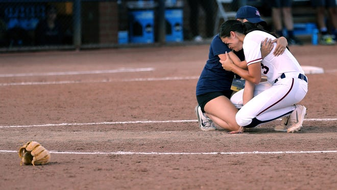Arizona starting pitcher Danielle O'Toole (3) gets a bit of consolation in the pitcher's circle after the Wildcats dropped a 6-5 deciding game in their NCAA Super Regional against Baylor at Hillenbrand Stadium, Sunday, May 28, 2017, Tucson, Ariz.  Kelly Presnell / Arizona Daily Star