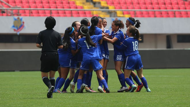 In this file photo, Guam's under-15 girls national team, celebrates after Jinae Teria scored a goal off a Minami Rabago free kick in the 64th minute in the EAFF U15 Girls Tournament at the Jinshan Sports Center main stadium in Shanghai, China.
