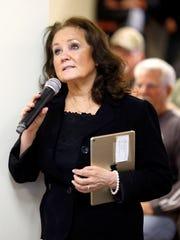 Rita Lewis asks a question about recent pension cuts