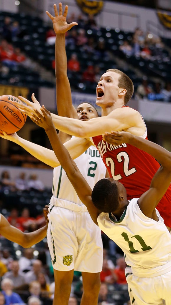 Bryce Bennington of Twin Lakes drives to the basket