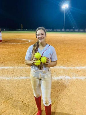 Bryan County High School's Kenzie Mobley shows off her three homers in sweep of Atkinson County.