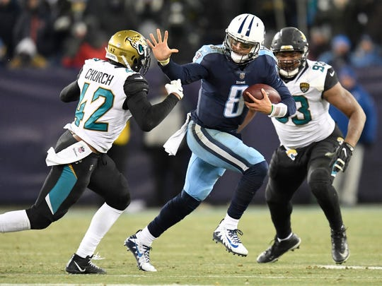 Titans quarterback Marcus Mariota (8) scrambles for a first down late in the fourth quarter of the team's playoff-clinching win over the Jaguars at Nissan Stadium Sunday, Dec. 31, 2017 in Nashville, Tenn.