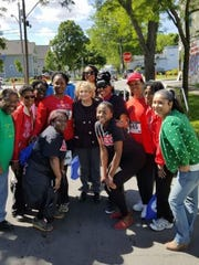 Rep. Louise Slaughter, center,  attended an annual 5K walk put on by Conkey Cruisers and other community organizations in Rochester. Conkey Cruisers Founder and Executive Director Theresa Bowick is pictured next to Slaughter on the right.