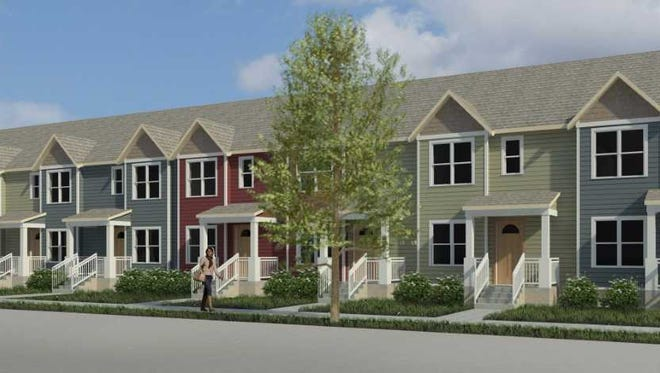 The delayed Washington Park Townhomes affordable apartments development is now moving forward.