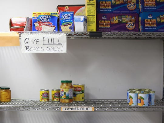 This September 2015 photo shows pantry shelves at the Center for Food Action in Englewood.