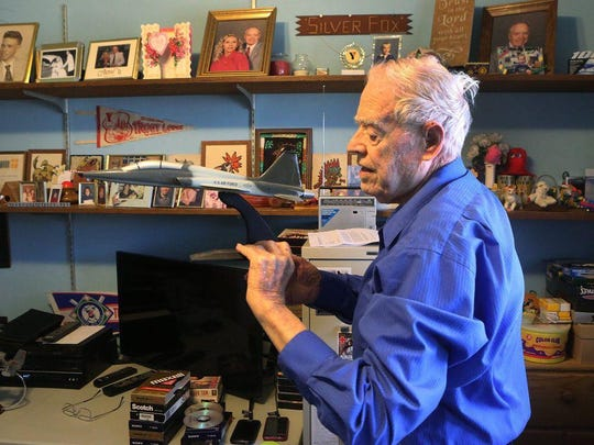 Bob King, 87, proudly shows off a model of the T-38C trainer that he worked on during his days at Boeing.
