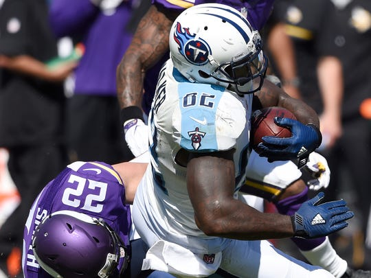 Titans tight end Delanie Walker (82) is brought down by Vikings free safety Harrison Smith (22) late in the fourth quarter Sunday.