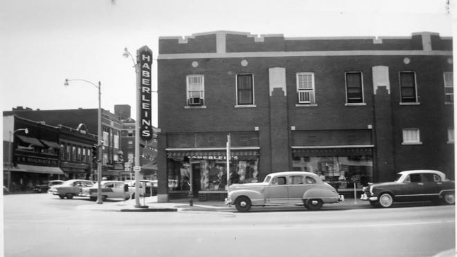 Then and Now. The building located at 101 S Main Street in El Dorado.  In 1955, it was home to Haberlein's.