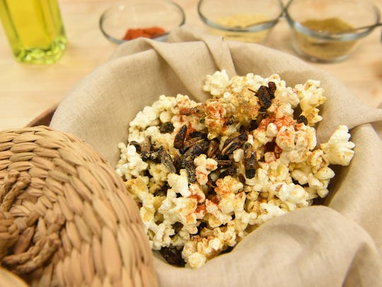 Spiced candied cricket popcorn, a dish made with crickets